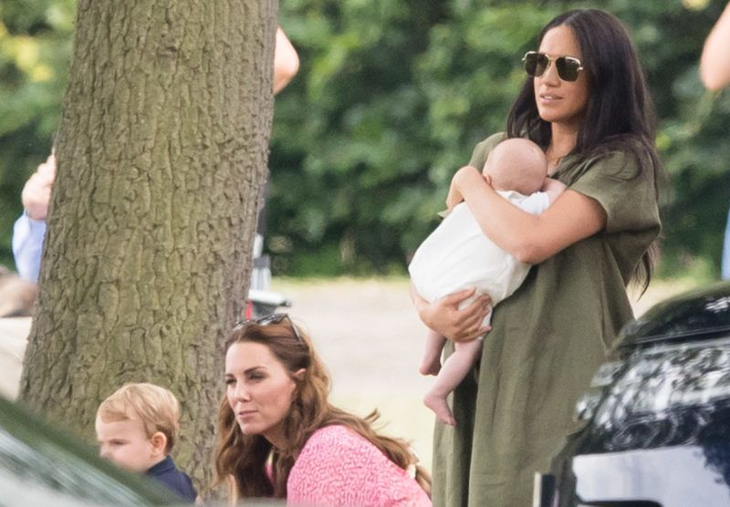 WOKINGHAM, ENGLAND - JULY 10: Meghan, Duchess of Sussex and Archie Harrison Mountbatten-Windsor, Catherine, Duchess of Cambridge and Prince Louis attend The King Power Royal Charity Polo Day at Billingbear Polo Club on July 10, 2019 in Wokingham, England. (Photo by Samir Hussein/WireImage)
