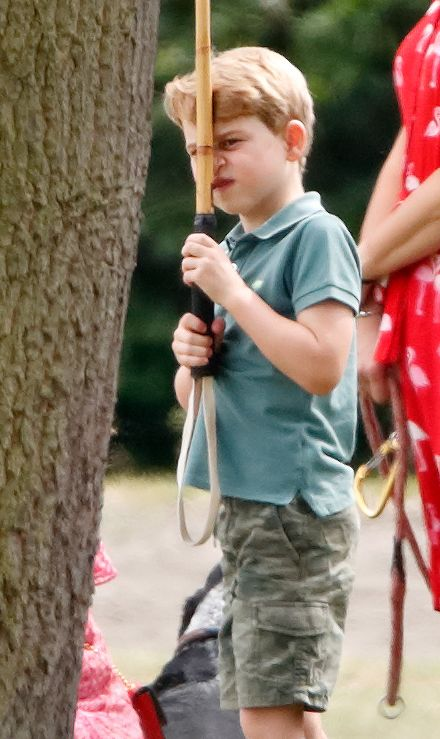 WOKINGHAM, UNITED KINGDOM - JULY 10: (EMBARGOED FOR PUBLICATION IN UK NEWSPAPERS UNTIL 24 HOURS AFTER CREATE DATE AND TIME) Prince George of Cambridge plays with a polo mallet as he attends the King Power Royal Charity Polo Match, in which Prince William, Duke of Cambridge and Prince Harry, Duke of Sussex were competing for the Khun Vichai Srivaddhanaprabha Memorial Polo Trophy at Billingbear Polo Club on July 10, 2019 in Wokingham, England. (Photo by Max Mumby/Indigo/Getty Images)