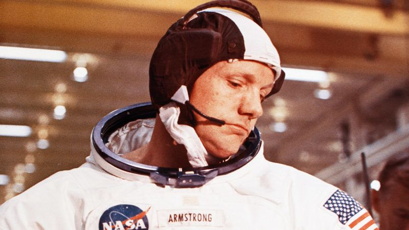Neil Armstrong, mission commander for the Apollo 11 moon mission, puts on and checks out each element of his space suit before boarding the space capsule. July 1969. (Photo by © CORBIS/Corbis via Getty Images)