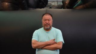 """Chinese artist Ai Weiwei poses for photos at a press preview of the 21st Biennale in Sydney on March 12, 2018. - Ai Wei Wei is exhibiting his work titled """"Law of the Journey 2017"""" depicting the plight of refugees in Europe at the Biennale which will run from March 16 - June 11, 2018. (Photo by PETER PARKS / AFP) / RESTRICTED TO EDITORIAL USE - MANDATORY MENTION OF THE ARTIST UPON PUBLICATION - TO ILLUSTRATE THE EVENT AS SPECIFIED IN THE CAPTION"""