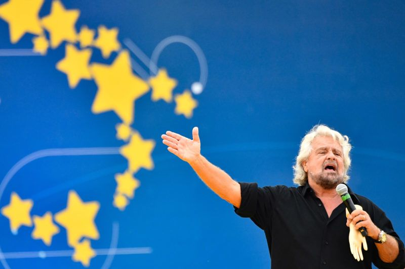 Founder of the Five Star Movement (M5S), Italian comedian and political activist Beppe Grillo speaks during a convention of the governing coalition's populist movement on October 21, 2018 in Rome. (Photo by Alberto PIZZOLI / AFP)