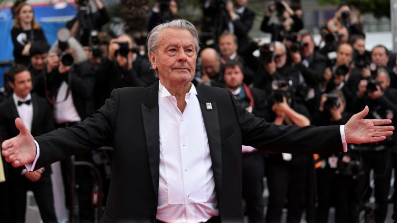 French actor Alain Delon arrives to be awarded with an Honorary Palme d'Or at the 72nd edition of the Cannes Film Festival in Cannes, southern France, on May 19, 2019. (Photo by CHRISTOPHE SIMON / AFP)