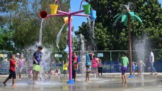 Children cool off at a water park in Alhambra, California on July 27, 2019 as southern California endures another summer heatwave with triple-digit temperatures. (Photo by Frederic J. BROWN / AFP)