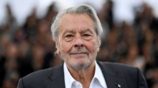 """(FILES) This file photo taken on May 19, 2019 shows French actor Alain Delon posing during a photocall before being awarded with an Honorary Palme d'Or at the 72nd edition of the Cannes Film Festival in Cannes, southern France. - French actor Alain Delon, aged 83, had a cardiovascular accident and a """"slight"""" cerebral hemorrhage a few weeks ago and is now """"recovering"""" in a clinic in Switzerland, his son Anthony Delon told AFP on August 8, 2019. (Photo by CHRISTOPHE SIMON / AFP)"""