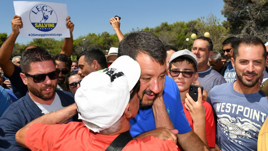 """A supporter kisses Italy's Interior minister and deputy Prime Minister Matteo Salvini during his electoral tour """"Italian Summer Tour"""", in Policoro, South of Italy, on August 10, 2019. - Salvini was pulling out all the stops on August 10, 2019 to rally supporters for a snap election after he withdrew his League party from an increasingly acrimonious coalition government, plunging the country into turmoil. (Photo by Alberto PIZZOLI / AFP)"""