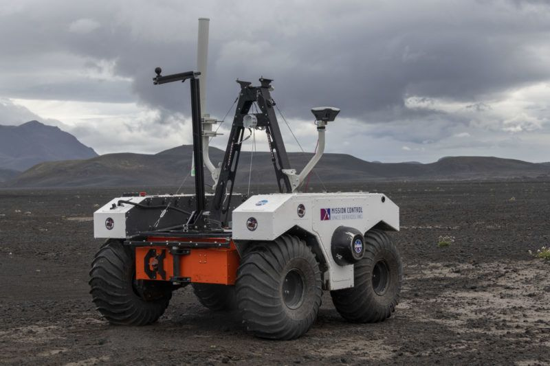 In this picture taken on July 19, 2019 shows the NASA's new robotic space explorer at their base at the Lambahraun lava field in Iceland where they are getting it ready for the next mission to Mars. - To prepare for the next mission to Mars in 2020, NASA has taken to the lava fields of Iceland to get its new robotic space explorer ready for the job. With its black basalt sand, wind-swept dunes and craggy peaks, the Lambahraun lava field at the foot of Iceland's second biggest glacier, Langjokull, was chosen as a stand-in for the Red Planet's surface. (Photo by Halldor KOLBEINS / AFP)