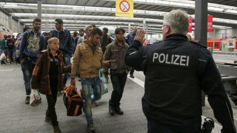2697631 09/10/2015 Refugees from the Middle East at a railway station in Munich. Sergey Stroitelev/Sputnik