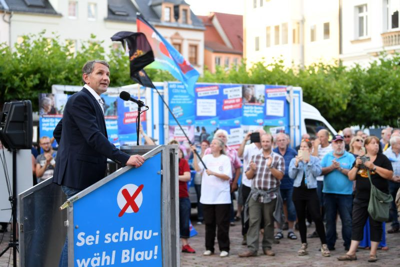 08 August 2019, Saxony, Döbeln: Björn Höcke (l), chairman of the AfD in Thuringia, speaks at an election campaign event of his party in Döbeln. On 01 September 2019 a new state parliament will be elected in Saxony. Photo: Hendrik Schmidt/dpa-Zentralbild/ZB
