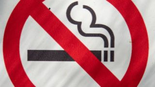 Photo of a no smoking sign taken in Mexico City on December 4, 2018. (Photo by Omar TORRES / AFP)