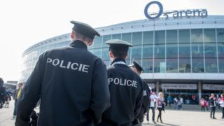 Police officers patrol the area as ice hockey fans arrive at the O2 Arena ice hockey stadium prior to the Ice hockey world championship match Switzerland vs Austria inPrague,Czeck Republic, 2 May 2015. Photo: Armin Weigel/dpa