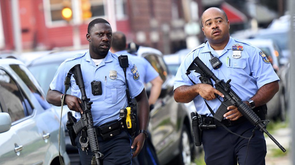 PHILADELPHIA, PA - AUGUST 14: Police officers carrying assault rifles respond to a shooting on August 14, 2019 in Philadelphia, Pennsylvania. At least six police officers were reportedly wounded in an hours-long standoff with a gunman that prompted a massive law enforcement response in the city's Nicetown-Tioga neighborhood.   Mark Makela/Getty Images/AFP