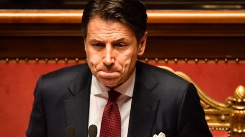 """Italian Prime Minister Giuseppe Conte reacts as he delivers a speech at the Italian Senate, in Rome, on August 20, 2019, as the country faces a political crisis. - Italy's Premier Conte says to offer resignation during his speech at the Senate after calling Italy's far-right Interior Minister Matteo Salvini """"irresponsible"""" to spark a political crisis by pulling the plug on the governing coalition. (Photo by Andreas SOLARO / AFP)"""