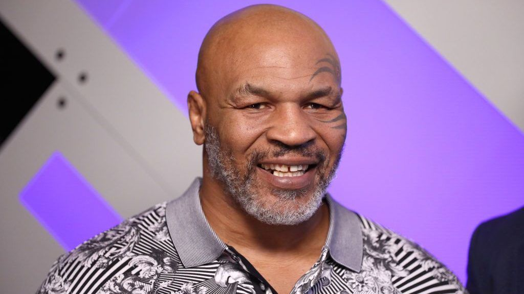 BURBANK, CALIFORNIA - JANUARY 18: (EDITORIAL USE ONLY. NO COMMERCIAL USE) Mike Tyson speaks with Mario Lopez at Capital One Podcast Studio during the 2019 iHeartRadio Podcast Awards Presented by Capital One at the iHeartRadio Theater LA on January 18, 2019 in Burbank, California. (Photo by Rich Polk/Getty Images for iHeartMedia)
