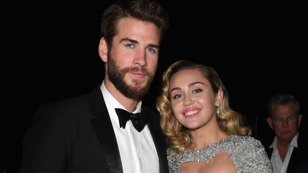 LOS ANGELES, CA - MARCH 04:  Liam Hemsworth (L) and Miley Cyrus attends Elton John AIDS Foundation 26th Annual Academy Awards Viewing Party at The City of West Hollywood Park on March 4, 2018 in Los Angeles, California.  (Photo by Venturelli/Getty Images for Bulgari)