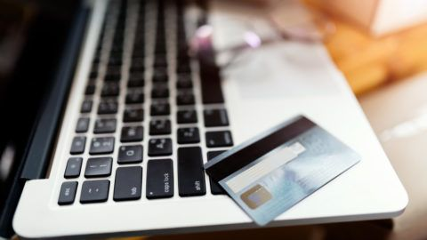 Credit card on laptop,online payment,shopping online concept.