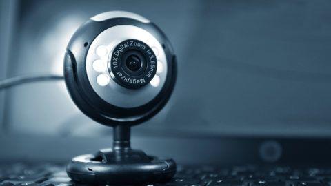Webcam in front of computer screen