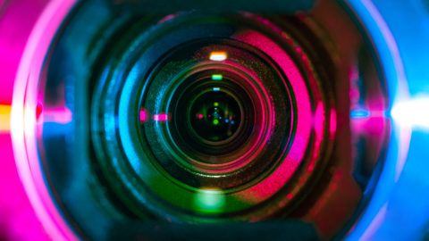 Video camera lens lit by different color light sources