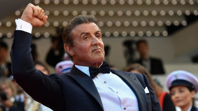 """US actor Sylvester Stallone gestures as he arrives for the screening of the film """"The Specials (Hors Normes)"""" at the 72nd edition of the Cannes Film Festival in Cannes, southern France, on May 25, 2019. (Photo by Alberto PIZZOLI / AFP)"""