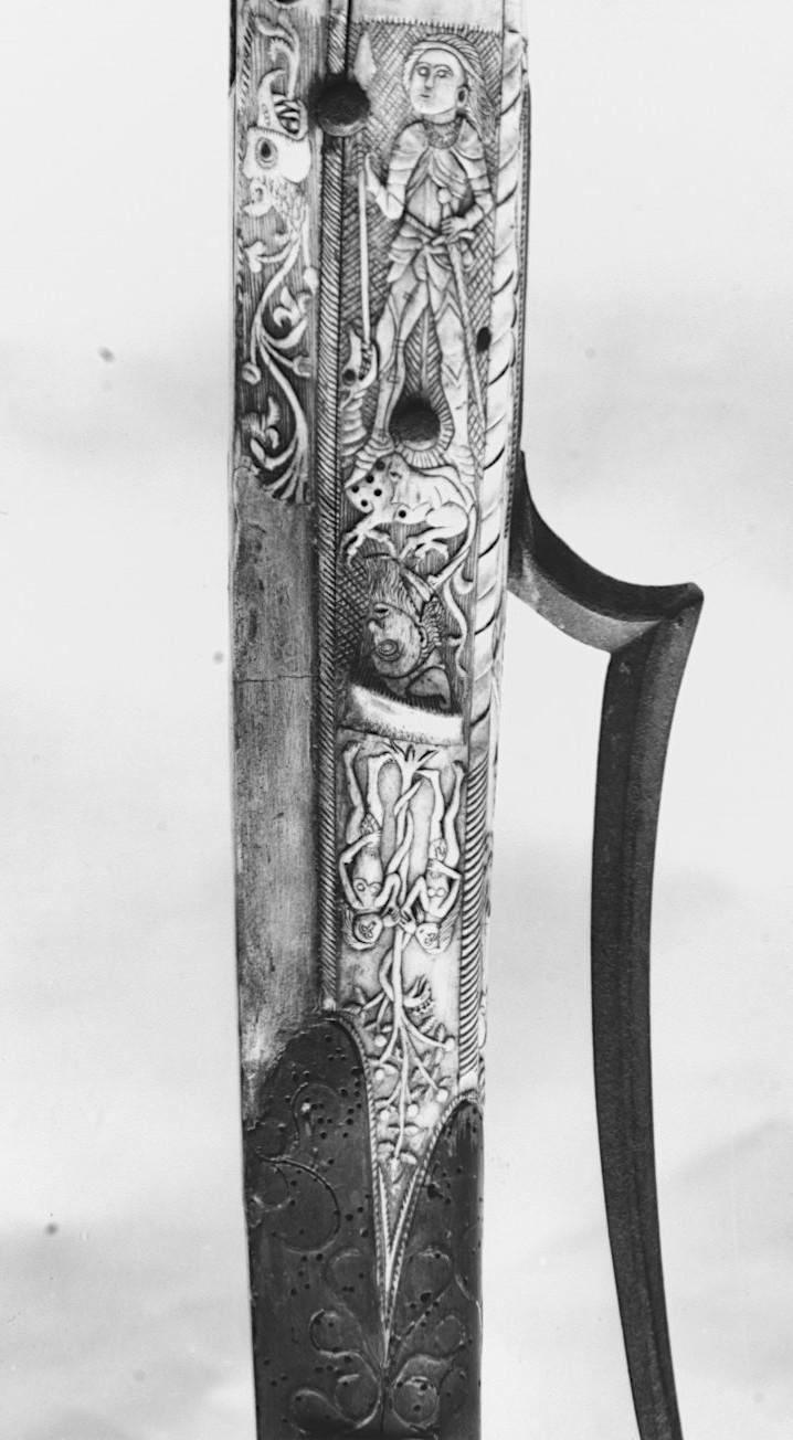 Szent György és a sárkány, alatta a fejjel lefelé ábrázolt, meztelen Ádámmal és Évával, valamint a Tudás Fájára tekeredő kígyóval