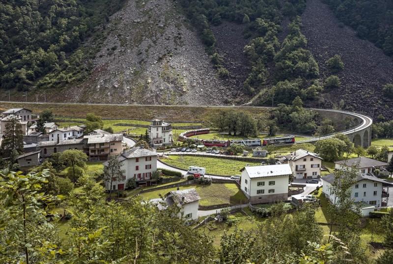 BRUSIO, SWITZERLAND - 2014/07/06: Bernina Express train at Brusio spiral viaduct in Valposchiavo, Grisons. (Photo by Olaf Protze/LightRocket via Getty Images)