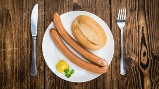 Fresh made German Sausages (Wiener) on a vintage background (close-up shot)