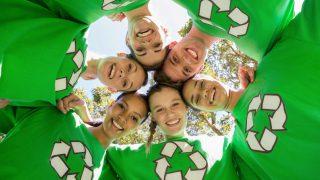 38132722 - environmental activists smiling at camera on a sunny day