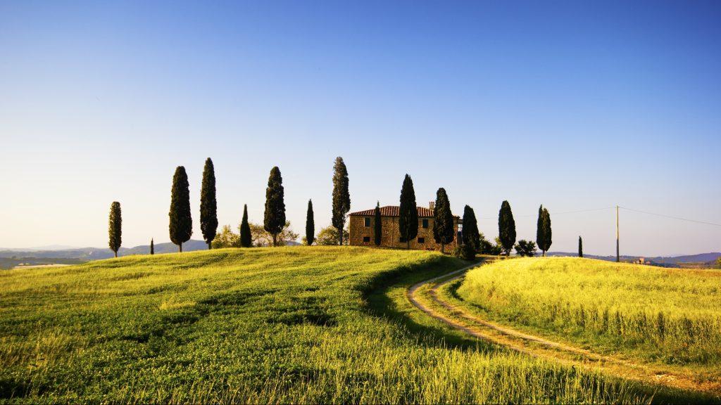 Beautiful Farmhouse and Cypress Trees in Tuscany, Italy.
