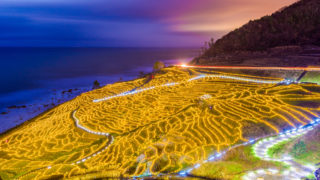 Wajima, Japan at Shiroyone Senmaida rice terraces at night.