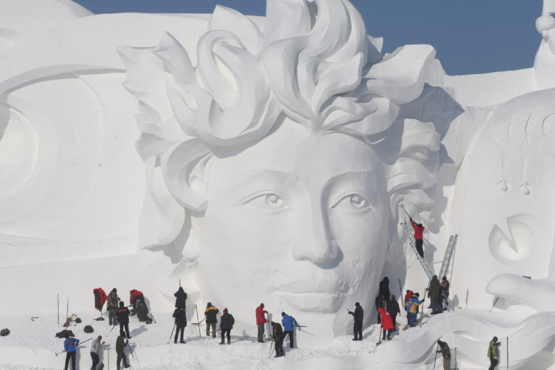 Artists and sculptors work on the main snow sculpture for the 31st Harbin Sun Island International Snow Sculpture Art Exposition in Harbin city, northeast China's Heilongjiang Province, 25 December 2018.  Staff members worked on the main sculpture at the Harbin Sun Island International Snow Sculpture Art Expo in Harbin, Heilongjiang Province on Tuesday, December 25, 2018. The 33-meter-high sculpture, which is almost complete, has attracted a lot of visitors during a preview opening of the exhibition, which officially opens to the public on Saturday. The snow sculpture art expo will run for around two months.