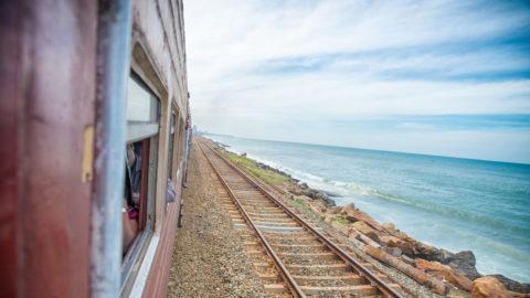 train rides along the the ocean shore