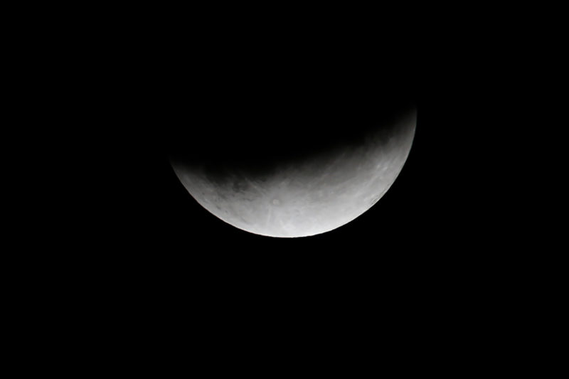 Picture taken on July 16, 2019 shows moon eclipse in Cognocoli-Monticchi on the French Mediterranean island of Corsica. (Photo by PASCAL POCHARD-CASABIANCA / AFP)