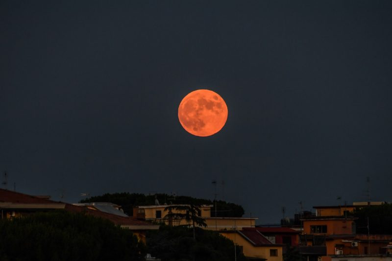 The moon rising the sky over Rome, before a lunar eclipse, on July 16, 2019. (Photo by Andreas SOLARO / AFP)