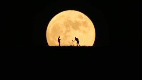 VAN, TURKEY - JULY 16:  The full moon rises behind photographers' silhouettes in Van, Turkey on July 16, 2019. Ozkan Bilgin / Anadolu Agency