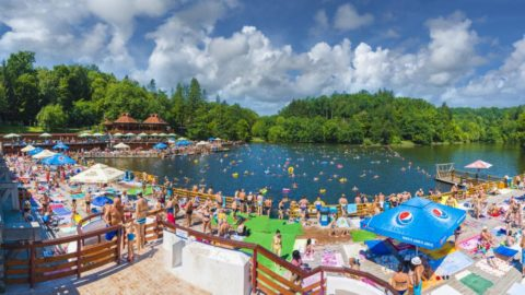 Sovata, Romania - August 5, 2018: Mountain resort with heliothermal Lake Ursu on Sovata, Transylvania, Romania.