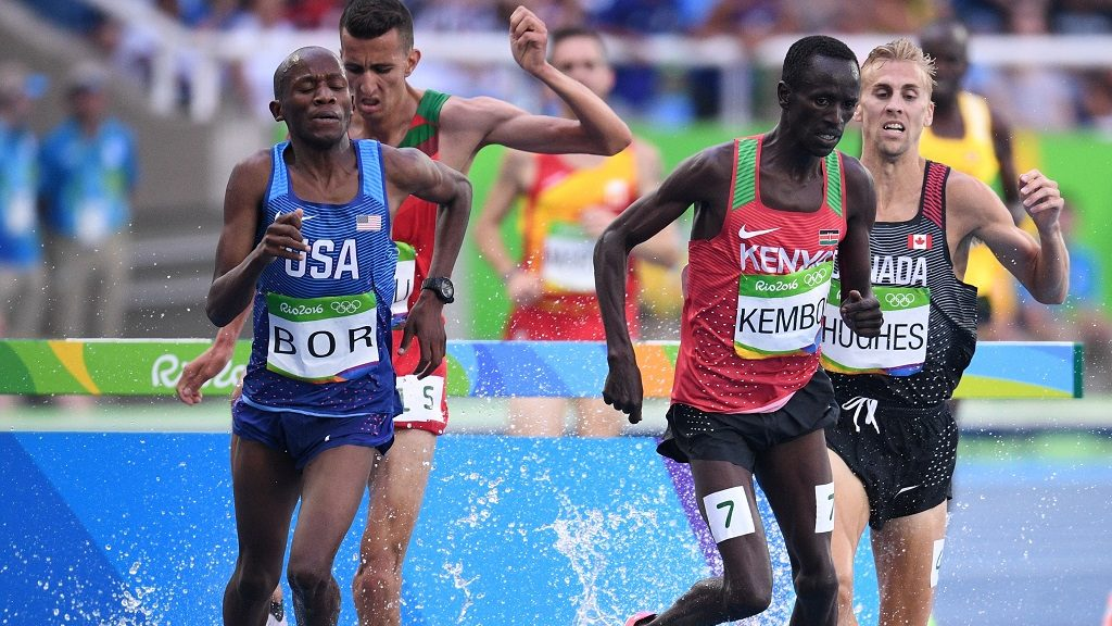 (LtoR) USA's Hillary Bor, Kenya's Ezekiel Kemboi and Canada's Matthew Hughes compete in the Men's 3000m Steeplechase Round 1 during the athletics event at the Rio 2016 Olympic Games at the Olympic Stadium in Rio de Janeiro on August 15, 2016.   / AFP PHOTO / Johannes EISELE
