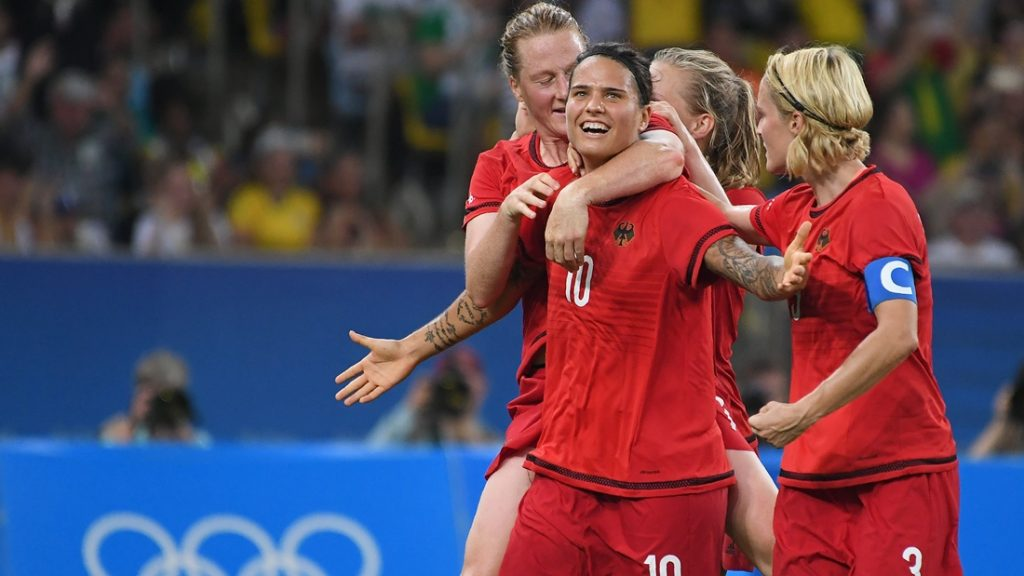 Germany's striker Dzsenifer Marozsan (C) celebrates with teammates their team's second goal during the Rio 2016 Olympic Games women's football Gold medal match at the Maracana stadium in Rio de Janeiro, Brazil, on August 19, 2016. / AFP PHOTO / Luis Acosta