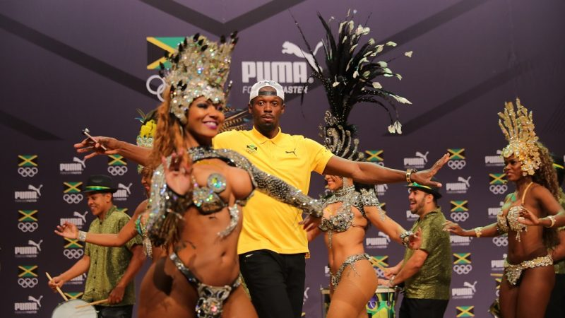 Athlete Usain Bolt of Jamaica dances with Samba dancers during a press conference of the Jamaican Olympic Association and PUMA in Barra during the Rio 2016 Olympic Games in Rio de Janeiro, Brazil, 8 August 2016. Photo: Michael Kappeler/dpa