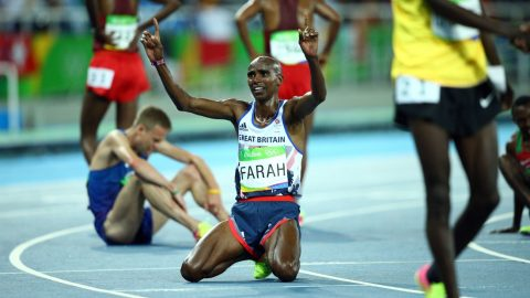 RIO DE JANERIO, BRAZIL - AUGUST 13: Mo Farah (C) of Great Britain reacts after he won gold medal after the Men's 10,000m run of the Rio 2016 Olympic Games at the Olympic Stadium in Rio de Janeiro, Brazil on August 13, 2016. Okan Ozer / Anadolu Agency
