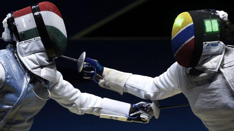 Rio de Janeiro, 2016. augusztus 10. Mohamed Aida (b) és a kolumbiai Saskia Loretta van Erven Garcia asszója a riói nyári olimpia nõi  tõrözõk egyéni versenyén a legjobb 32 között a Rio de Janeiró-i 3-as Karióka Arénában 2016. augusztus 10-én. Mohamed Aida gyõzött és bejutott a legjobb 16 közé. MTI Fotó: Kovács Tamás