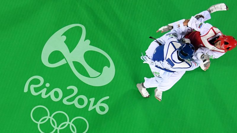 RIO DE JANEIRO, BRAZIL - AUGUST 20:  Abdoulrazak Issoufou Alfaga (Blue) of Niger competes against Radik Isaev of Azerbaijan  during the Men's +80kg Gold Medal contest on Day 15 of the Rio 2016 Olympic Games at Carioca Arena 3 on August 20, 2016 in Rio de Janeiro, Brazil.  (Photo by Jamie Squire/Getty Images)