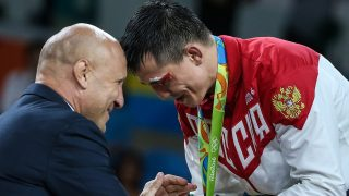 RIO DE JANEIRO, BRAZIL - AUGUST 14, 2016: Russian Wrestling Federation President Mikhail Mamiashvili (L) shakes hands with gold medallist Roman Vlasov of Russia at a victory ceremony for the men's -75kg Greco-Roman wrestling event at the Rio 2016 Summer Olympic Games, at Carioca Arena 2. Valery Sharifulin/TASS (Photo by Valery SharifulinTASS via Getty Images)