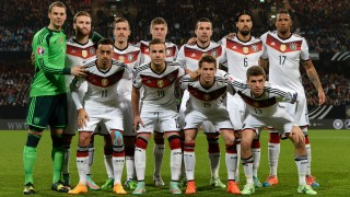 (FILES) This file photo taken on November 14, 2014 shows players of Germany's national football team posing prior to the UEFA 2016 European Championship qualifying round Group D football match Germany vs Gibraltar in Nuremberg, southern Germany: (row behind, L-R) Germany's goalkeeper Manuel Neuer, Germany's forward Max Kruse, Germany's midfielder Toni Kroos, Germany's midfielder Lukas Podolski, Germany's midfielder Sami Khedira and Germany's defender Jerome Boateng; (front row, L-R) Germany's forward Karim Bellarabi, Germany's forward Mario Goetze, Germany's defender Erik Durm and Germany's midfielder Thomas Mueller. / AFP PHOTO / CHRISTOF STACHE