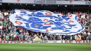 England fans hold a giant banner of the team's logo during the friendly football match between England and Turkey at the Etihad Stadium in Manchester, north west England, on May 22, 2016. / AFP PHOTO / PAUL ELLIS / NOT FOR MARKETING OR ADVERTISING USE / RESTRICTED TO EDITORIAL USE