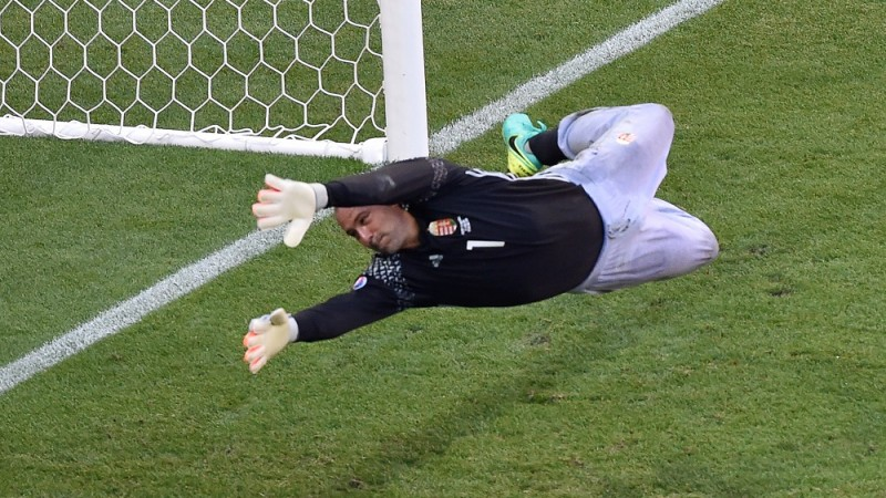 Hungary's goalkeeper Gabor Kiraly concedes a goal during the Euro 2016 group F football match between Hungary and Portugal at the Parc Olympique Lyonnais stadium in Decines-Charpieu, near Lyon, on June 22, 2016. / AFP PHOTO / JEAN-PHILIPPE KSIAZEK