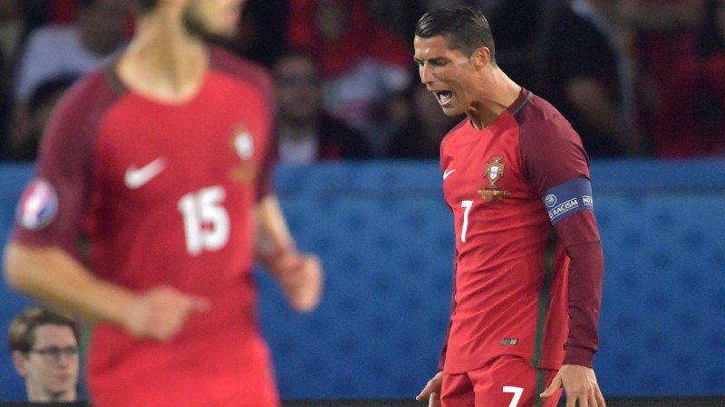 Cristiano Ronaldo of Portugal reacts during the UEFA Euro 2016 Group F soccer match Portugal vs. Austria at the Parc des Princes stadium in Paris, France, 18 June 2016. Photo: Peter Kneffel/dpa (RESTRICTIONS APPLY: For editorial news reporting purposes only. Not used for commercial or marketing purposes without prior written approval of UEFA. Images must appear as still images and must not emulate match action video footage. Photographs published in online publications (whether via the Internet or otherwise) shall have an interval of at least 20 seconds between the posting.)