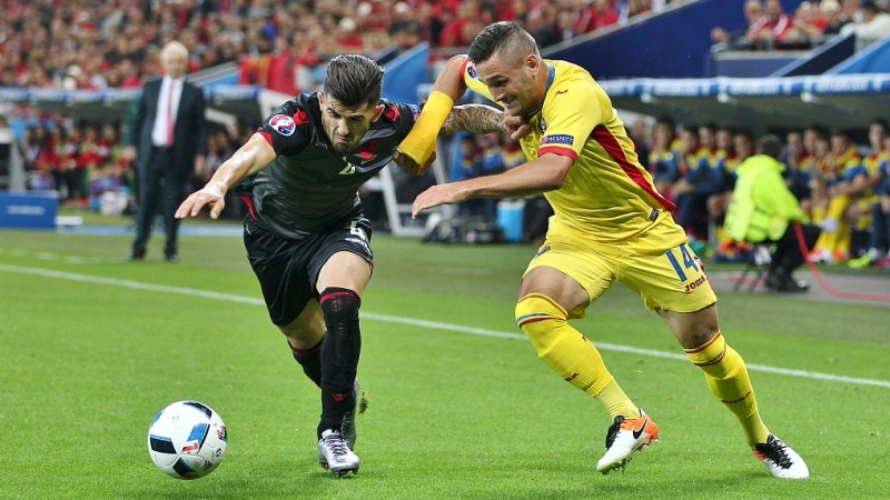 Elseid Hysaj of Albania and Florin Andone of Romania during the UEFA European Championships 2016 , group A match between Romania and Albania played at Stadium Lyon , Lyon , France on June 19th 2016 - Photo Michael Zemanek / BPI / DPPI