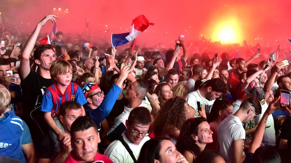 FRANCE, Marseille: Thousands of French fans gather in the fan zone of Marseille, southern France, to watch the Euro 2016 semi-final between France and Germany on a giant screen, on July 7, 2016. - Georges ROBERT