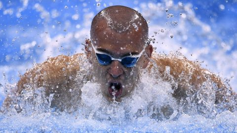 Hungary's Laszlo Cseh competes in a Men's 100m Butterfly heat during the swimming event at the Rio 2016 Olympic Games at the Olympic Aquatics Stadium in Rio de Janeiro on August 11, 2016.   / AFP PHOTO / CHRISTOPHE SIMON