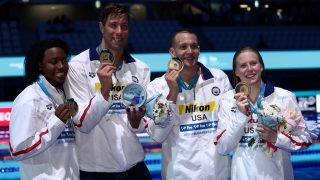 Team USA (LtoR) Simone Manuel, Matt Grevers, Caeleb Remel Dressel and Lily King pose with the gold medal during the podium ceremony for the mixed 4x100 medley final during the swimming competition at the 2017 FINA World Championships in Budapest, on July 26, 2017.  / AFP PHOTO / FERENC ISZA