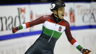 CALGARY, CANADA - NOVEMBER 6: Shaolin Sandor Liu of Hungary celebrates his first place finish in the men's 500 meter final during the ISU World Cup Short Track Speed Skating event November 6, 2016 in Calgary, Alberta, Canada.   Todd Korol/ISU via Getty Images/AFP
